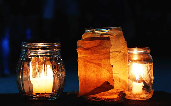 Create mood lighting by adding smaller candles & wrapping the outside with material